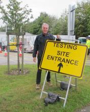 Cllr George Adamson outside testing site