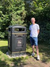 Councillor Johnson beside a jumbo bin