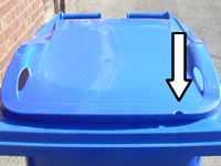 Blue bin with arrow showing where notch is removed on right hand side of front of lid