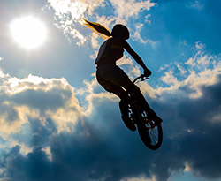 person on bmx in mid air